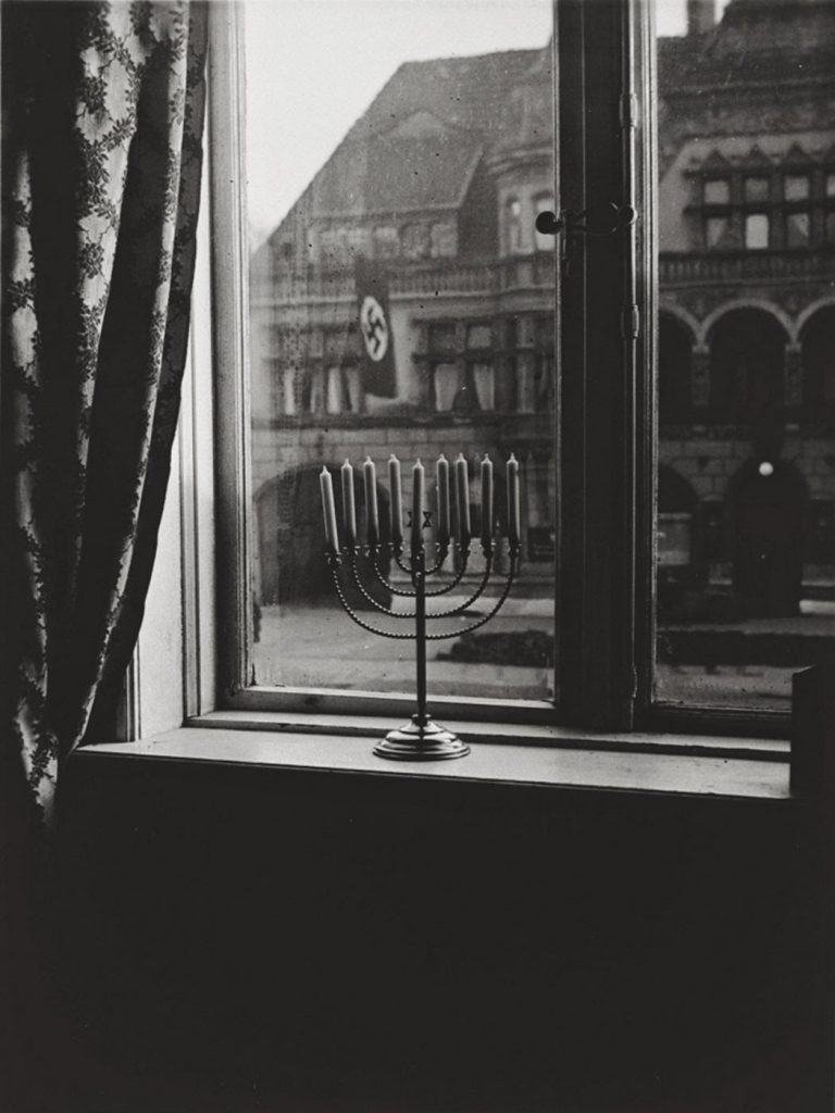 A menorah defies the Nazi flag , 1931